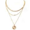 shine boutique, collier elisabeth, ensemble de colliers, collier multirangs, collier médaille
