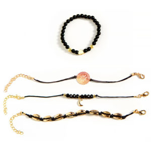 shine boutique, ensemble de bracelets noir cauri doré