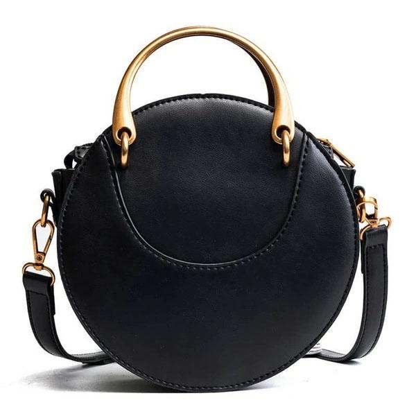 Petit sac à main rond en cuir vegan de couleur noir